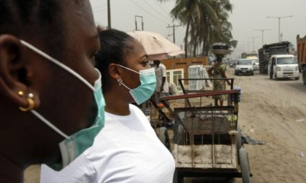 Pandemonium as Chinese woman falls, starts vomiting at Nigerian Immigration Services in Lagos