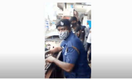 Ghanaian policemen harass and closes a Nigerian businessman's shop over $1m tax