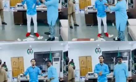 Abia state governor's Chief of Staff, Anthony Agbazuere, spraying Naira notes on clergyman, Odumeje Indaboski, in his office